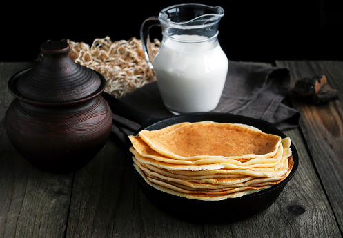 Blintzes in iron cast skilled, rustic still life