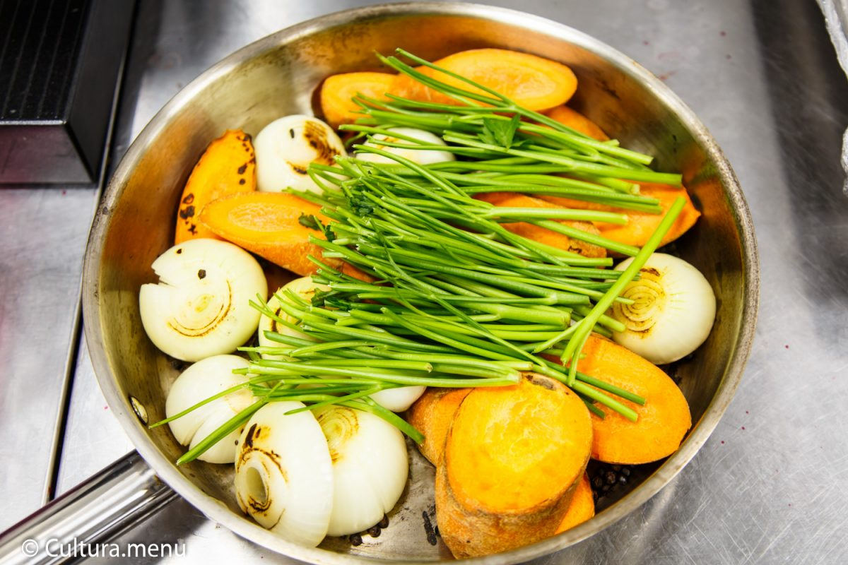 Vegetables ( carrots, onions and herbs) ready for cooking