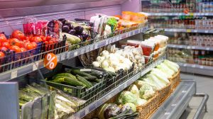 Shopping showcase in the supermarket with vegetables and fruit.